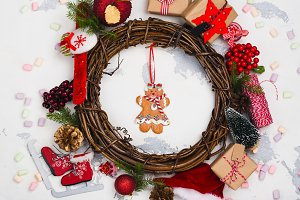 Christmas background with festive decorations, wreath and xmas toys of red colors
