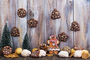 Mix of Christmas cookies on wooden table with Christmas decor