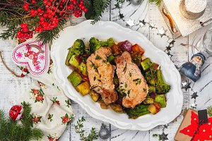 Christmas roasted pork with vegetables. Xmas decorated table