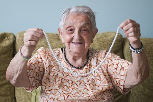 Elderly woman showing a necklace