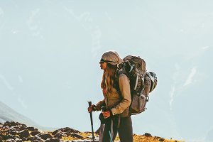 Woman traveling in mountains hiking
