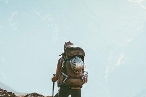 Traveler in mountains hiking