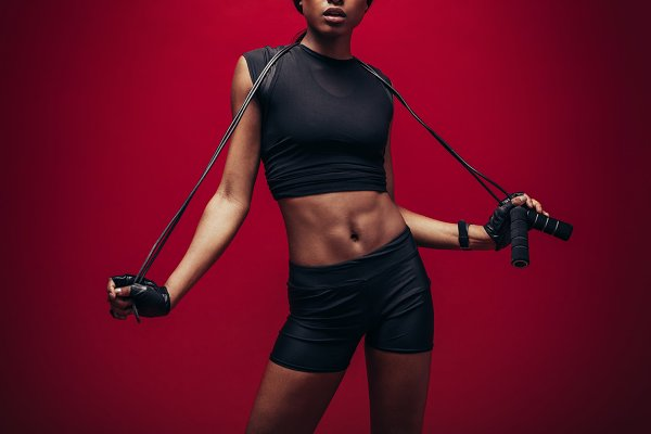 Female athlete with skipping rope