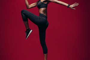 Sports woman jumping and stretching