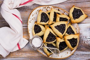 Traditional Jewish Hamantaschen cookies with berry jam. Purim celebration concept