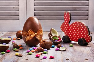 Easter chocolate eggs and decorative wooden bunny