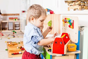 Boys play with wooden toys