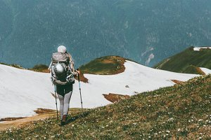 Travel in mountains woman hiking