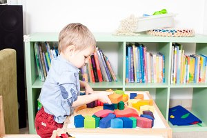 Boy playing with cubes