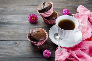 chocolate muffins and a cup of coffe