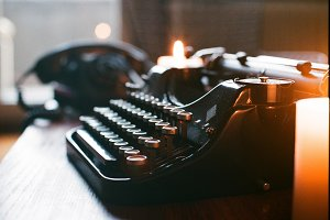 Vintage typewriter phone and candles