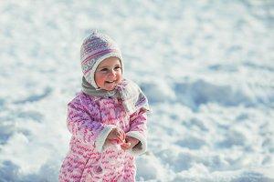 Girl enjoys the snow