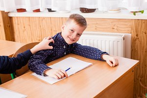 Boy white in the copybook