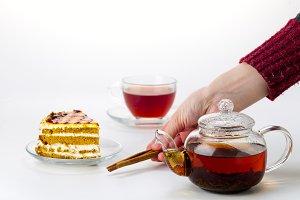 Teapot, tea cup and cake