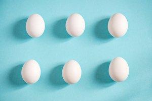 Fresh white eggs over blue background