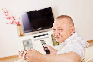 Smiling man watching TV