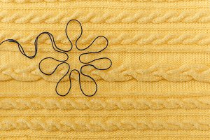 Yellow knitted background,braids.