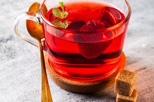 hot raspberry tea in transparent cup
