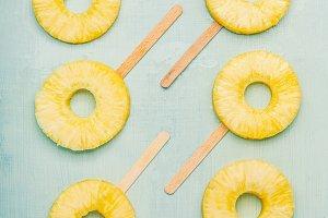 Pineapple slice popsicles flat lay