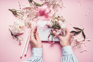 Hands with flowers and envelop