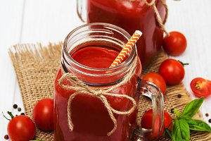 Jars with tomato juice