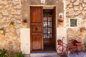 wooden door with bicycle