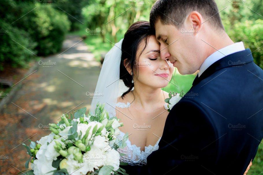 Lovely Wedding Couple Hugs Tender