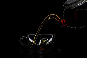 Transparent teapot with black tea