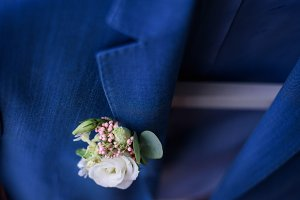 White boutonniere pinned to jacket