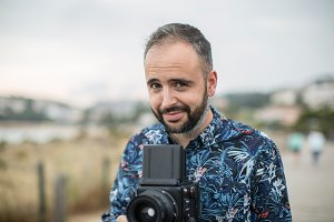 Cheerful man with camera