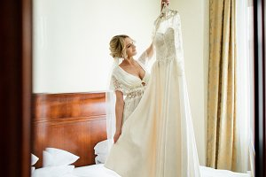 Beautiful blonde bride stands