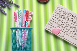 Colorful pens and keyboard. Pastel flat lay