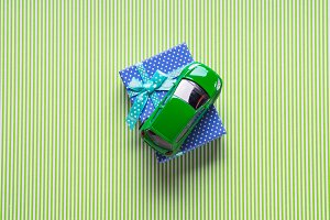Blue gift box and a toy car