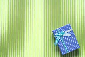 Blue gift box on green background