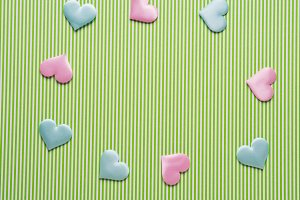 Pastel hearts on green striped background