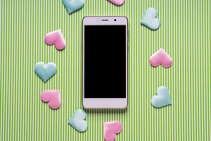 Smartphone with black screen and hearts