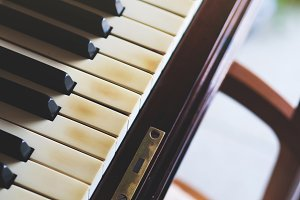 Old piano keys closeup