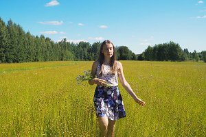 Summer landscape, girl, field of flax