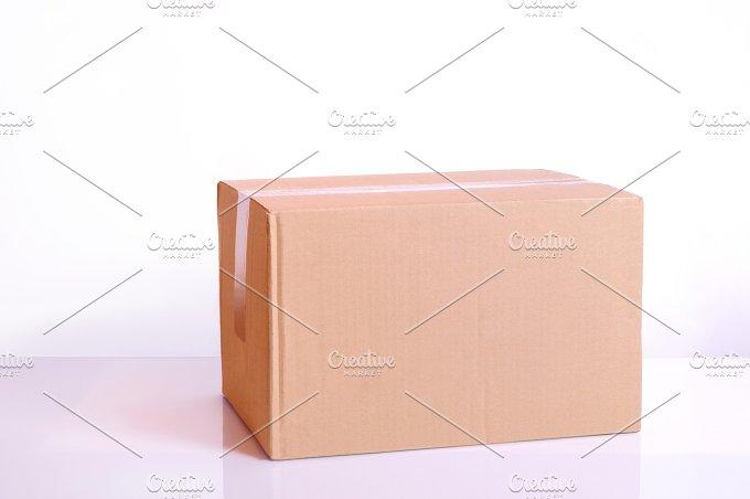 Cardboard box on a table.jpg - Transportation