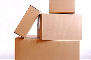Four cardboard boxes isolated.jpg