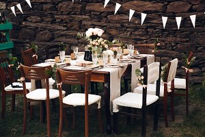 Little dinner table served in rustic