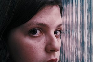 Young woman near a window