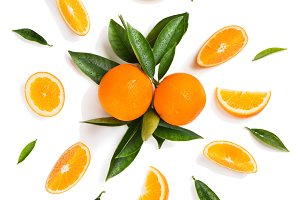 Citrus fruits and leaves - oranges.