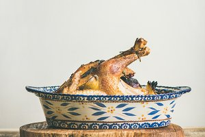 Roasted whole chicken for Christmas eve celebration table, copy space