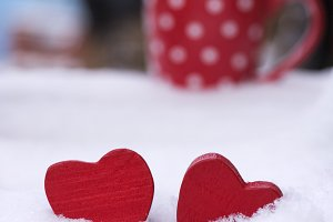 two wooden red hearts