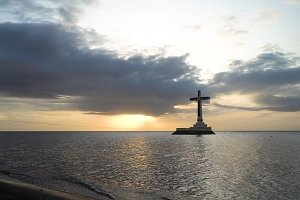 Catholic cross in the sea.