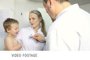 Doctor nurse trying calm down kid
