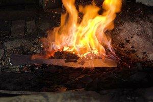 Blacksmith furnace with burning coals.
