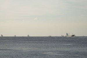 Cargo ships anchored in the sea. Philippines, Manila.