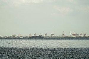 Cargo ship sails on the sea. Philippines, Manila.